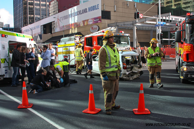 Car accident in Queen St, Auckland, New Zealand. Firefighters and ambulance arrived to the scene.