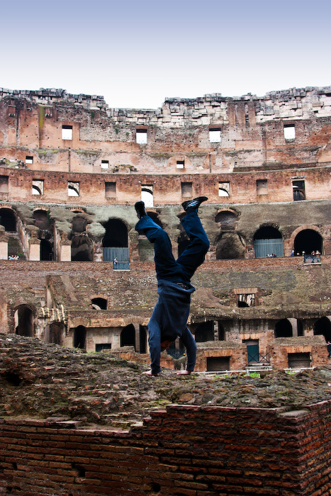 Handstand amongst the ruins of Coliseum in Rome