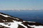 View from Mt Ruapehu, Mt Taranaki's snowy peak is visible in the background