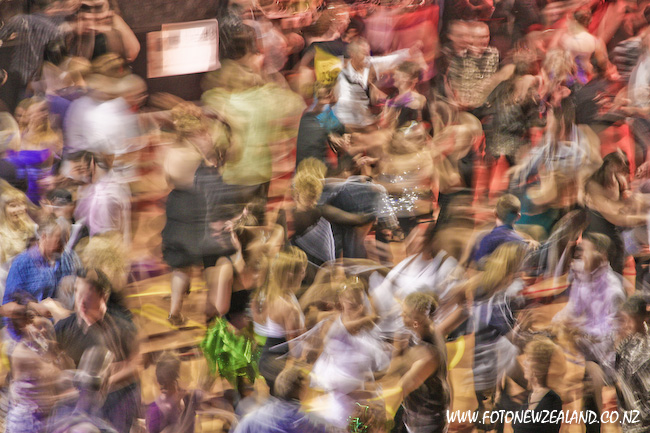 Crowd on the dancing floor in motion blur