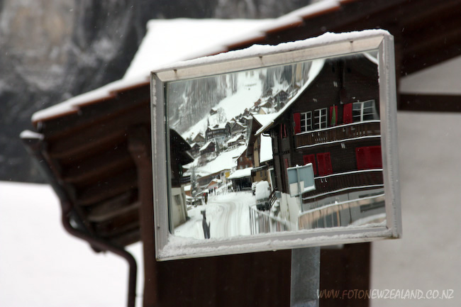 Snow-covered houses in Lauterbrunnen Switzerland